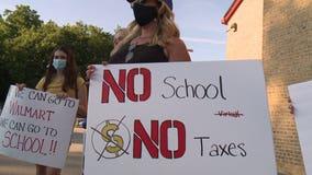 Waukesha School District votes to start school year using 'hybrid model'
