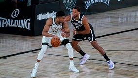 Giannis watches in 2nd half as Nets beat Bucks 119-116
