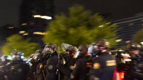 Protesters clash with federal agents in Portland outside US immigration building