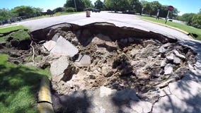 Sinkhole swallows portion of road, closes Racine County's Quarry Lake Park