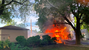 Fire engulfs garage in Waukesha; no injuries reported