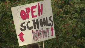 'Can't shut down our lives:' Mequon-Thiensville parents protest, calling for in-person learning this fall