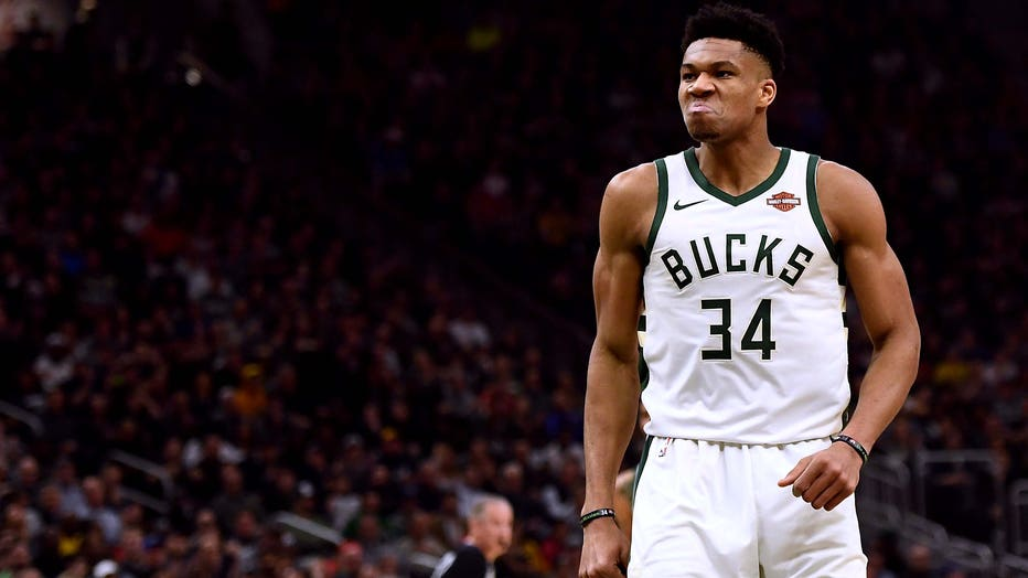 MILWAUKEE, WISCONSIN - MARCH 26: Giannis Antetokounmpo #34 of the Milwaukee Bucks reacts after a dunk against the Houston Rockets during the first half of a game at Fiserv Forum on March 26, 2019 in Milwaukee, Wisconsin. NOTE TO USER: User expressly acknowledges and agrees that, by downloading and or using this photograph, User is consenting to the terms and conditions of the Getty Images License Agreement. (Photo by Stacy Revere/Getty Images)