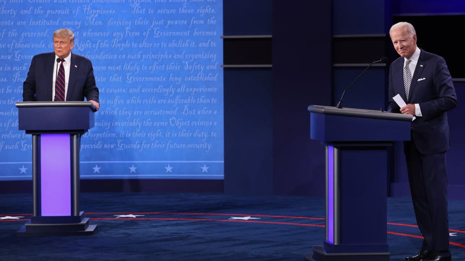 FILE - U.S. President Donald Trump and Democratic presidential nominee Joe Biden look out to the audience at end of the first presidential debate at the Health Education Campus of Case Western Reserve University on September 29, 2020 in Cleveland, Ohio.