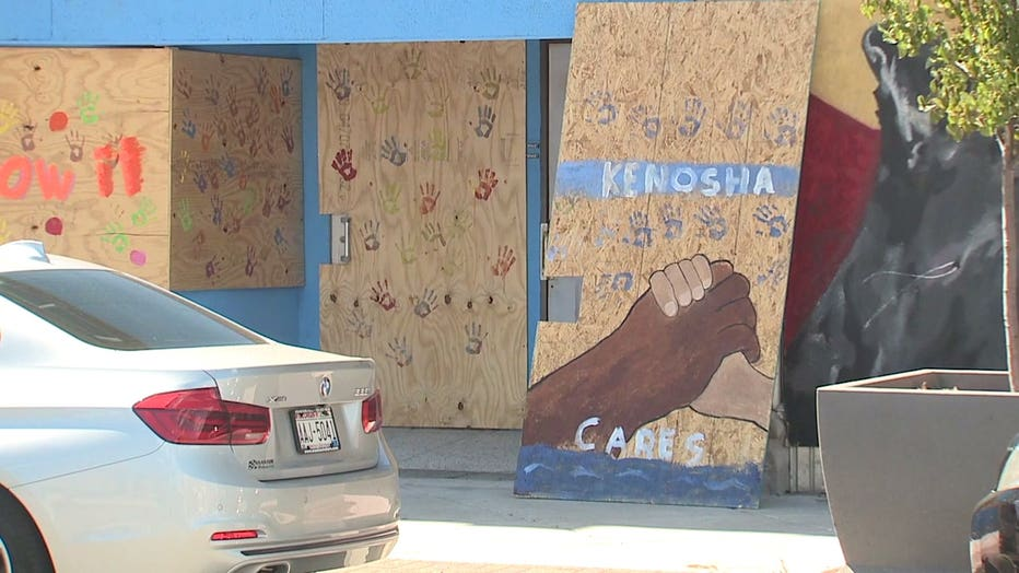 Messages painted on boarded Kenosha businesses