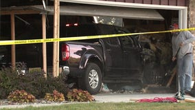 Pickup truck slams into house, driver sustains minor injuries