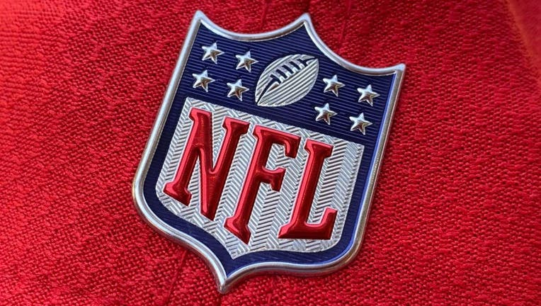The official NFL logo is seen on the back of a hat