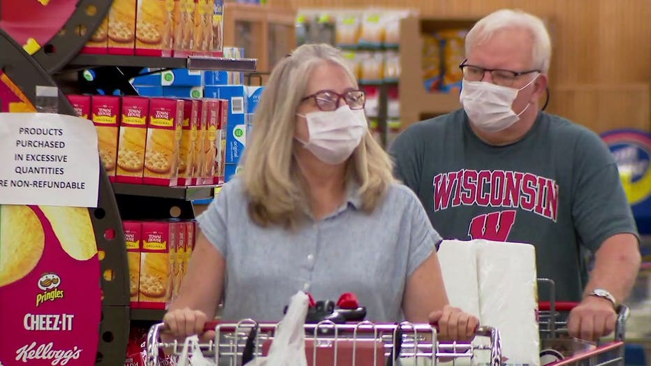 People wearing masks while grocery shopping in Wisconsin during the COVID-19 pandemic