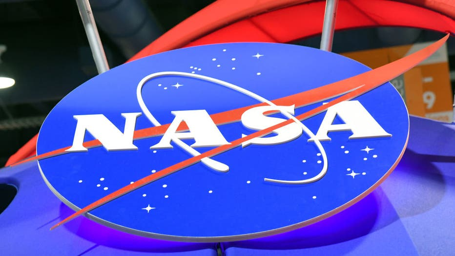 The NASA logo is displayed at the agency's booth during CES 2018 at the Las Vegas Convention Center on January 11, 2018 in Las Vegas, Nevada. The space agency said that an asteroid will make a close-approach to Earth on April 29. (Photo by Ethan Miller/Getty Images)