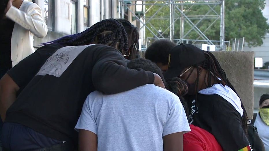 Alvin Cole's family prays before meeting with Milwaukee County District Attorney John Chisholm