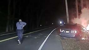 NJ police officer rescues man trapped in burning car