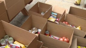 Record number of families show up to mobile food pantry in West Bend