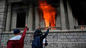Protesters burn part of Guatemala's Congress building amid budget cuts to education, health spending