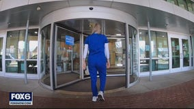 UWM basketball player interns at hospital