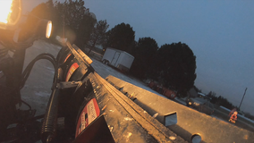 Plows out as snow falls in Milwaukee suburbs