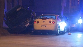 MPD: 2 people hurt after car slams into parked vehicle