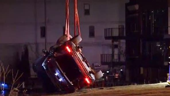 Pursuit ends in crash along Milwaukee River, 2 rescued, 1 sought
