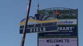 American Family Field sign hoisted onto tower