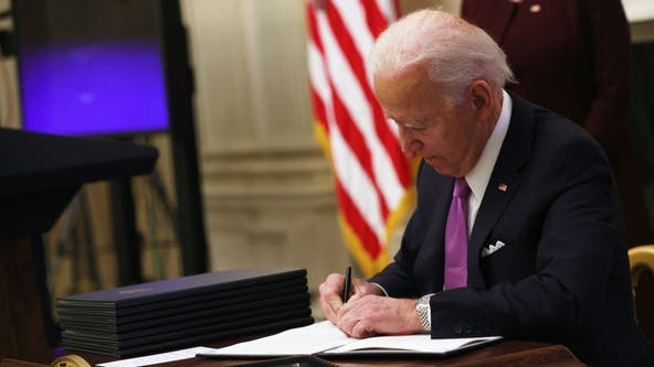 Biden signs executive orders on $15 minimum wage for federal workers, food aid increases