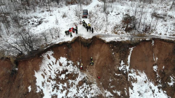Grafton rescue 2 women, dog from muddy bluff in Lions Den Park
