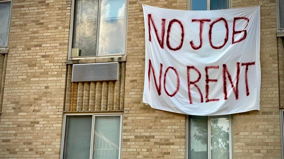 FILE - A banner against renters eviction is displayed on a controlled rent building in Washington, D.C. on Aug. 9, 2020.