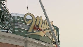 Crews begin to remove large Miller Park sign from stadium