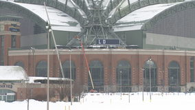 Crews work to place 52,000-pound sign on American Family Field