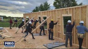 Franklin High School students help build home