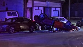 Driver loses control of car, strikes parked vehicles before rolling over
