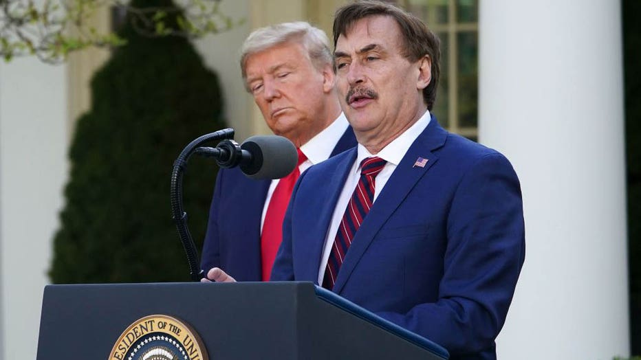 FILE - Then-President Donald Trump listens as Mike Lindell, CEO of MyPillow Inc., speaks during the daily briefing on COVID-19 in the Rose Garden of the White House in Washington, DC, on March 30, 2020. (Photo by MANDEL NGAN/AFP via Getty Images)