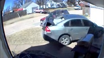 Man arrested after video captures him 'intentionally' driving car into ex-wife's vehicle and home, police say