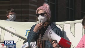 Group protests Marquette layoffs, calls for worker reinstatement