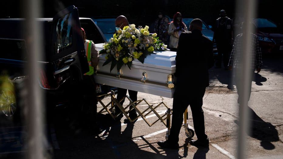 FILE - A casket is loaded into a hearse at the Boyd Funeral Home on Jan. 14, 2021 in Los Angeles, California.