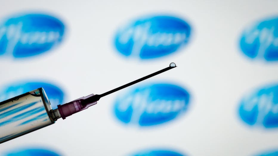 FILE - The Pfizer logo is seen with a syringe and needle in this photo illustration on March 1, 2021. (Photo by Jaap Arriens/NurPhoto via Getty Images)