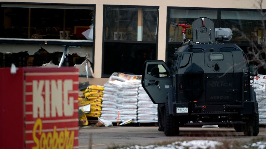 An armored vehicle is parked outside the entrance of the King Soopers grocery store in Boulder, Colorado where a mass shooting took place on March 22, 2021. (Photo by JASON CONNOLLY/AFP via Getty Images)