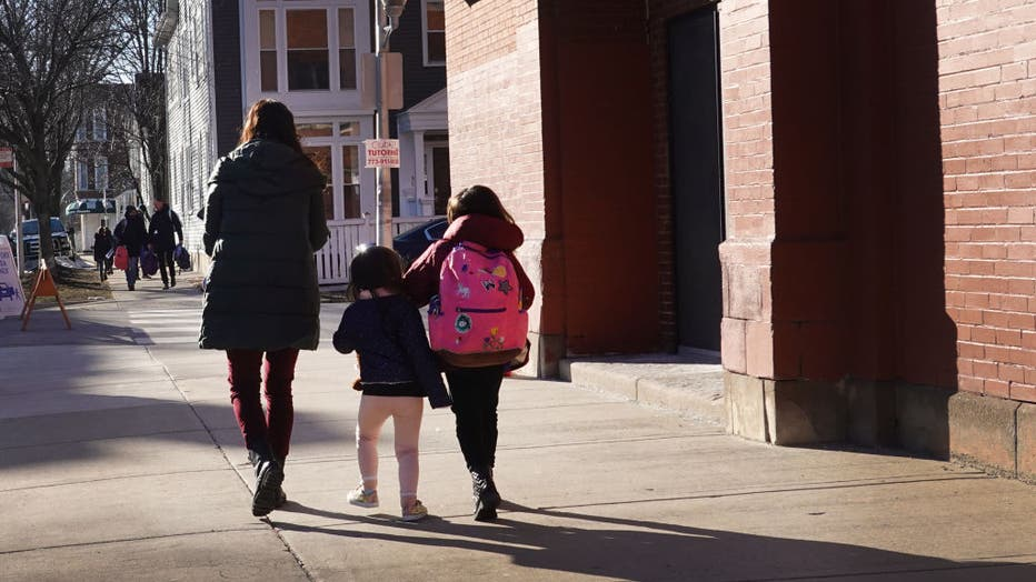 FILE - Parents pick up their children from school on March 1, 2021 in Chicago, Illinois. (Photo by Scott Olson/Getty Images)