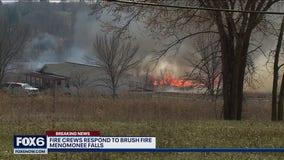 Authorities battle Menomonee Falls brush fire
