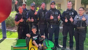 Tempe police officers surprise boy with new toy gator tractor after his old one was stolen