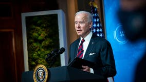 Biden signs executive order raising federal contract workers' minimum wage to $15 an hour
