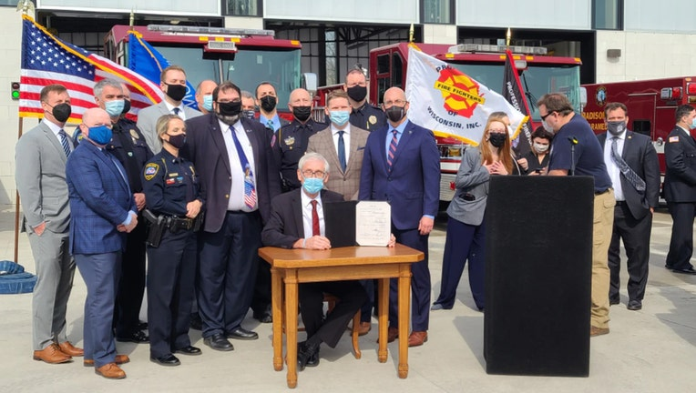 Gov. Tony Evers signs a bill to make it easier emergency responders suffering from post-traumatic stress disorder to file worker's compensation claims, on Tuesday, April 27, 2021.(WMTV-TV/Curt Lenz)