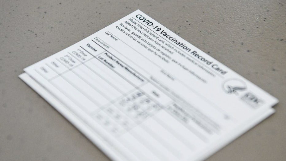 FILE - A Covid-19 vaccine record card is shown in a file image. (CHANDAN KHANNA/AFP via Getty Images)