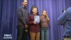 Racine student wins award for sanitizer dispenser design