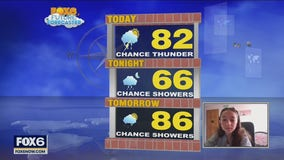 11-year-old Natalie helps with the weather