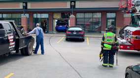 Car into Fox Point building, no injuries
