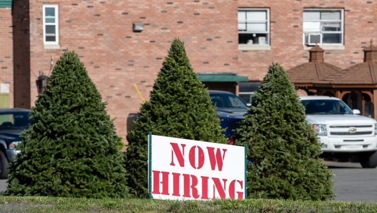 FILE - A now hiring sign is seen outside the International Paper's corrugated box manufacturing plant on May 13, 2021, in Mount Caramel, Pennsylvania. (Photo by Paul Weaver/SOPA Images/LightRocket via Getty Images)