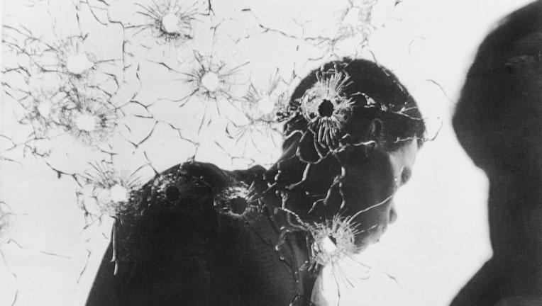 Man Behind Bullet-Riddled Glass