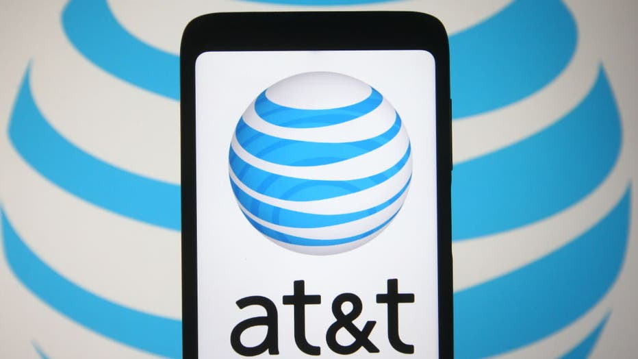 In this photo illustration the AT&T logo is seen on a
