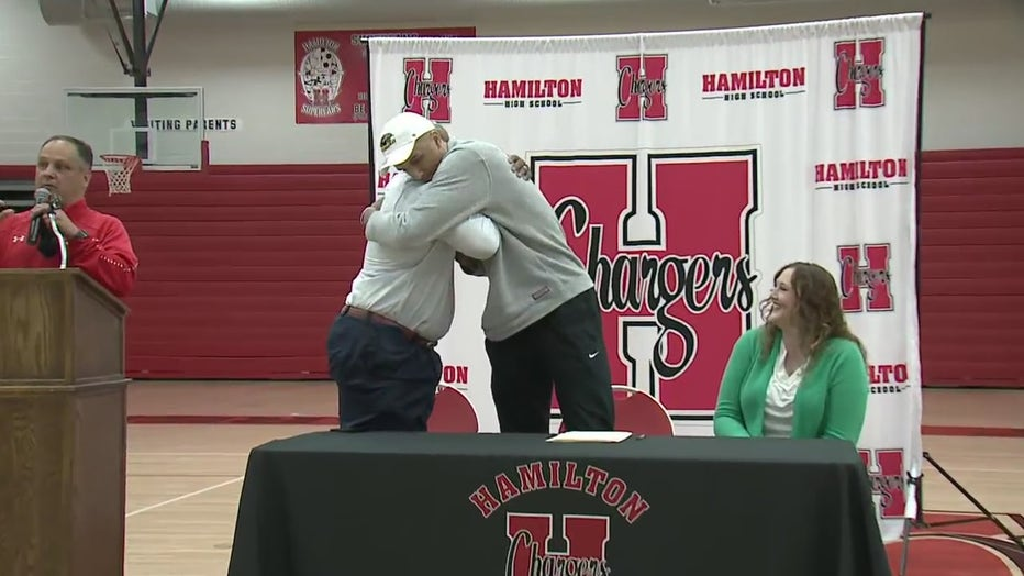 Patrick Baldwin Jr. embraces his father and new head coach