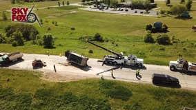 Gravel truck overturns in East Troy