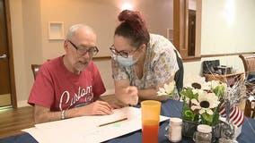 Whitewater senior living collects postcard from all 50 states